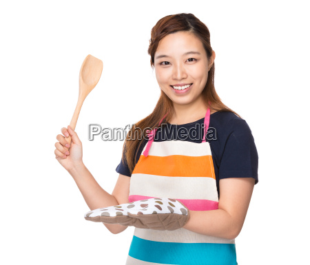 asian housewife hold with wooden ladle