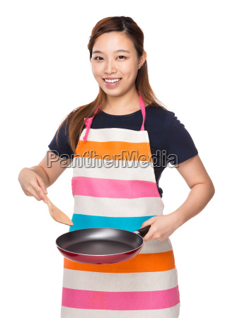 housewife cooking with fried pan and