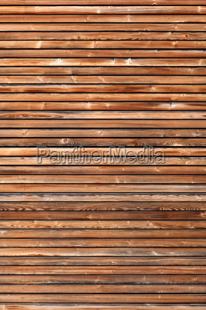 wooden facade with horizontal slat in