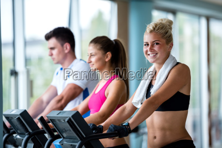 friends exercising on a treadmill