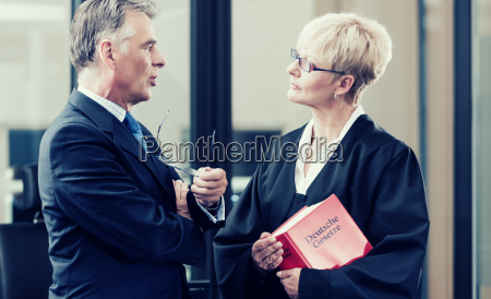 lawyer with statute book and client