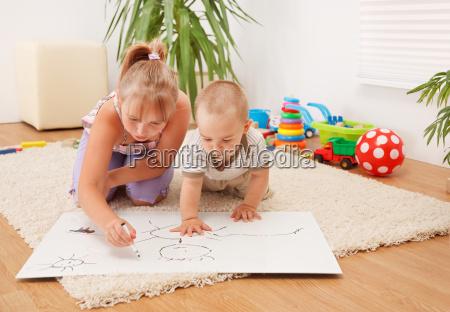 children drawing in room