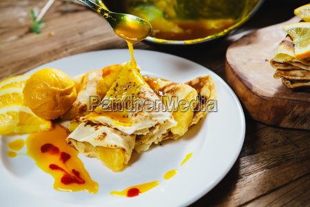 stuffed pancakes with orange syrup and