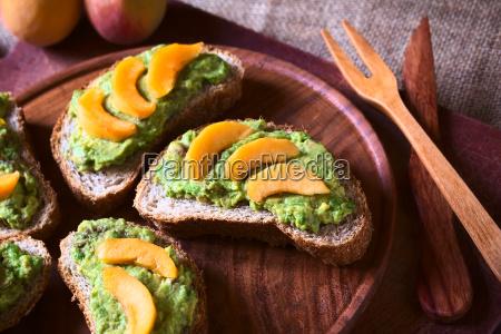 wholegrain bread with avocado and peach
