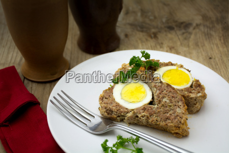 baked meatloaf with boiled eggs for