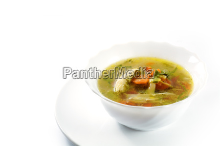 chicken soup with vegetables in a