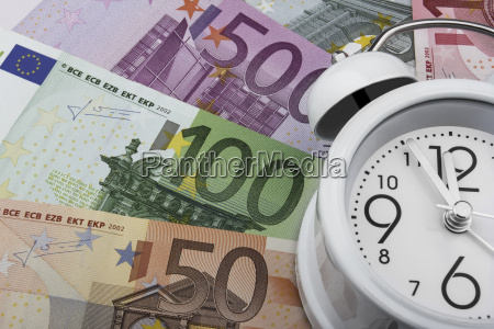 euro notes and clock business concept