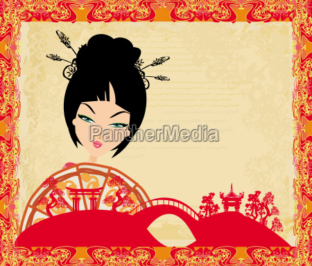 attractive asian woman holding traditional fan