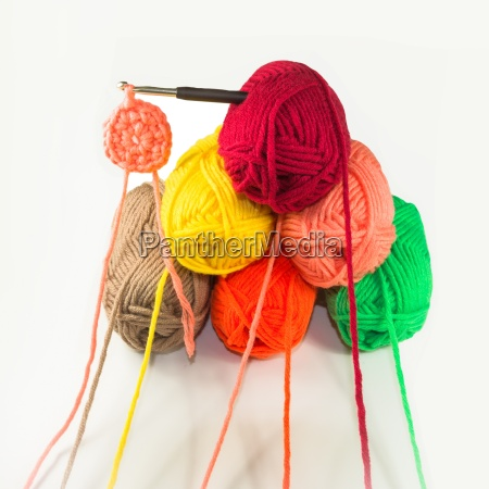 many balls of wool with crochet