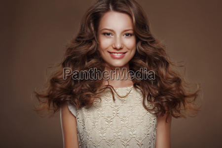beautiful happy brunette with long curly