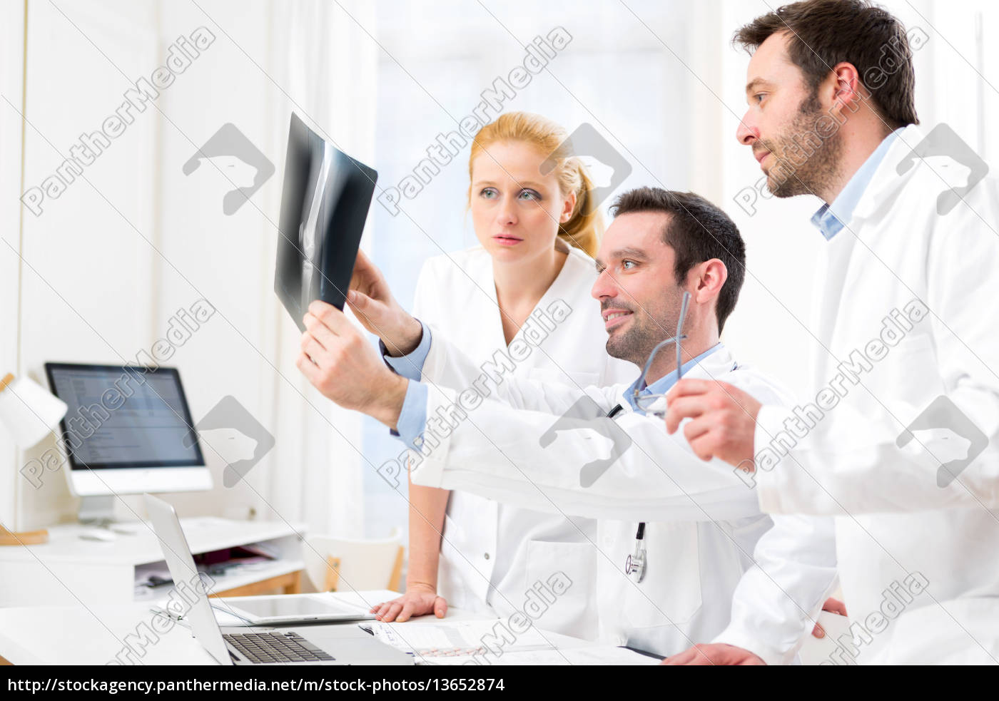 medical, team, analysing, together, a, x - 13652874