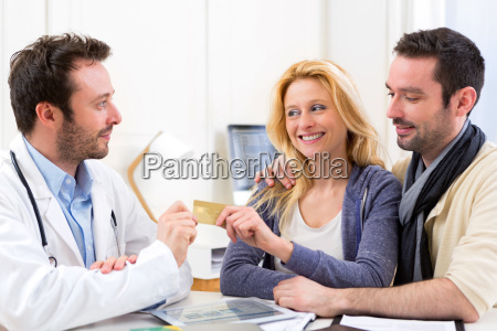 young attractive couple paying consultation to