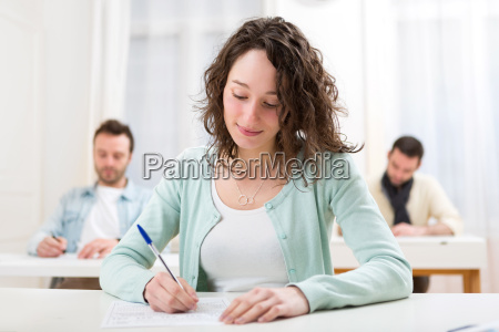 young attractive student during lessons at