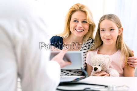 little girl at the doctor with