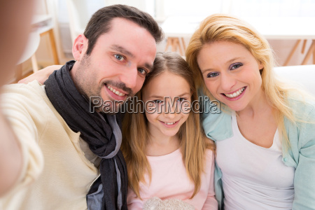 happy family in a sofa taking