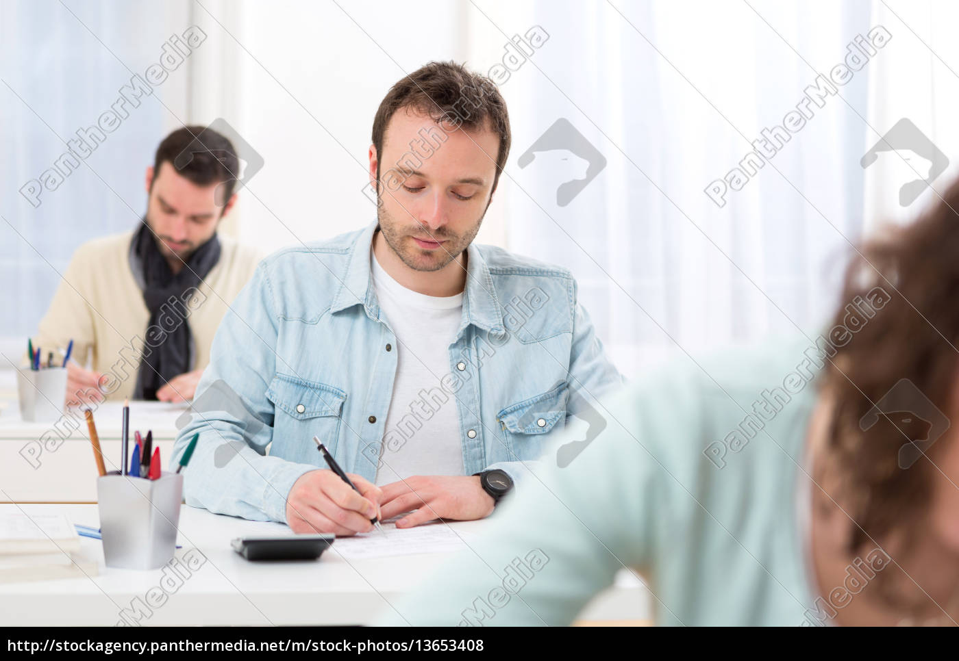 young, attractive, man, taking, exams - 13653408