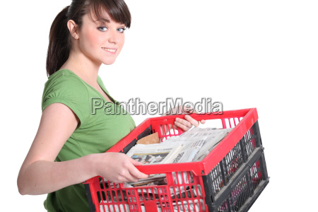 woman carrying newspapers