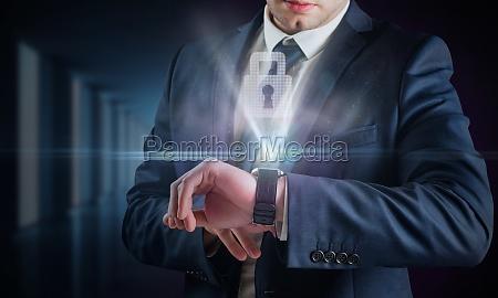 composite image of businessman using hologram