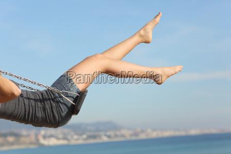 hair removed woman legs swinging on