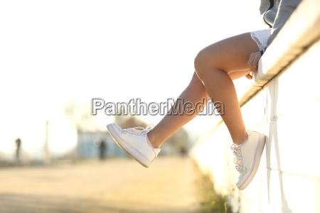 urban teenager legs wearing sneakers