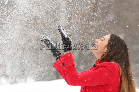 woman, in, red, throwing, snow, in - 13663770