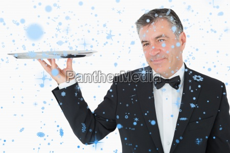 composite image of welldressed waiter holding