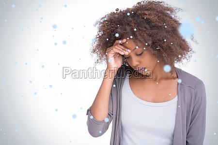 composite image of sad woman holding
