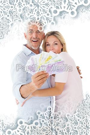 composite image of happy couple flashing