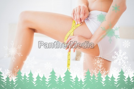 composite image of thin woman measuring