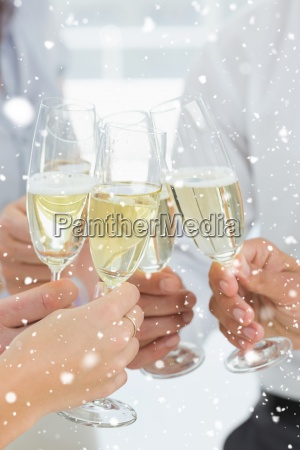 composite image of hands toasting with