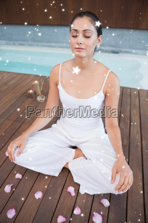 composite image of peaceful brunette in