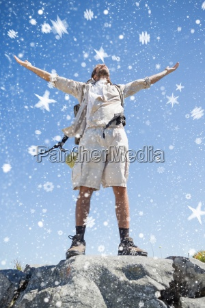 composite image of handsome hiker standing