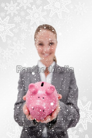 composite image of piggy bank being