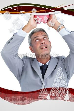 composite image of curious businessman holding