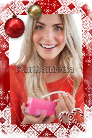 composite image of cheerful woman discovering