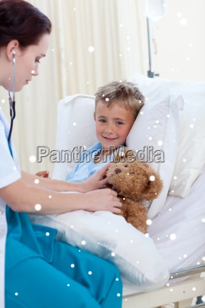 female doctor listening to a child