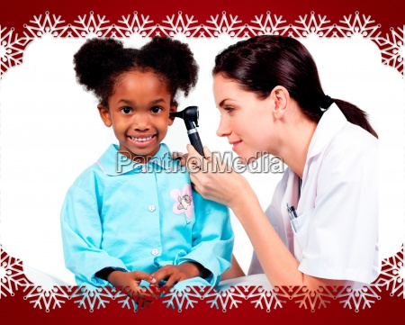 female doctor checking her patients ears