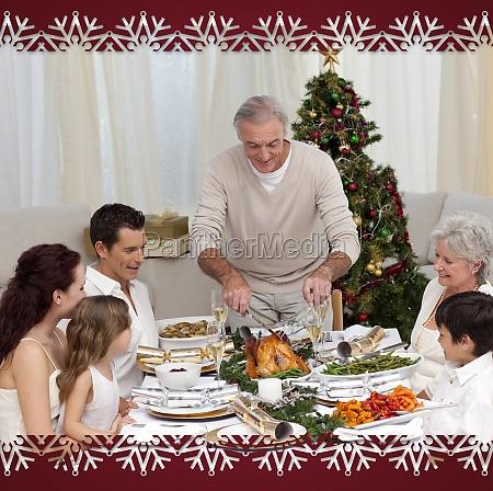 family having christmas dinner eating turkey