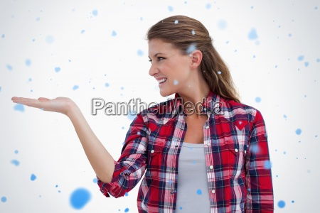 smiling woman displaying a copy space