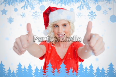 smiling young woman putting her thumbs