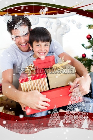 happy father and son holding christmas