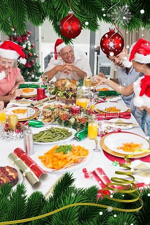 happy family in santas hats enjoying