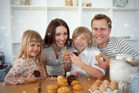 cute children eating muffins with their