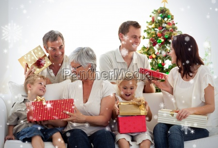 happy family at home opening christmas
