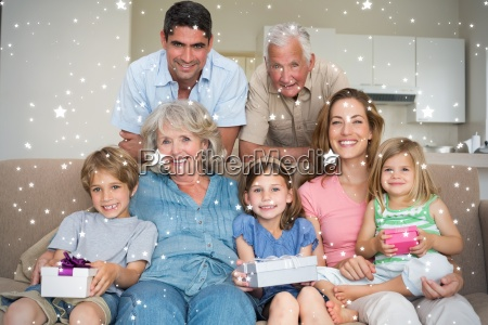 composite image of siblings holding gifts