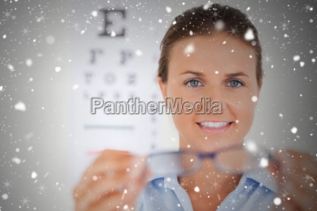 brunette eye specialist handing out glasses