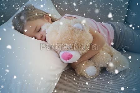 girl sleeping on sofa with stuffed