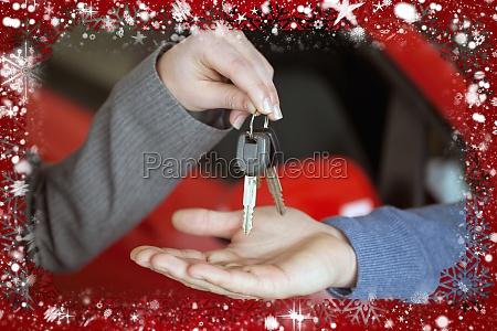 composite image of person handing keys