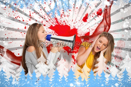 girl shouting at another through a