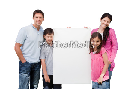 small family standing outside with a